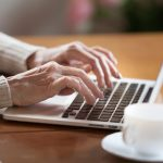 woman working laptop on adelaide bookkeeping
